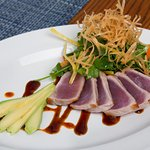 Chili Rubbed Ahi Tuna: soy reduction, cilantro salad