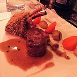 Lambchop with an amazing reduction,carrots, potatoes and baby onions