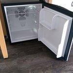Mini fridge keeping your drinks cool.
