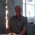 sorbet desert with a cake and sparkler.