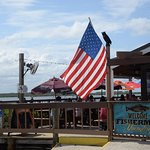 Old Glory flying over the outdoor deck at J.B.'s