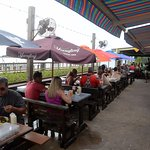 The outdoor deck under umbrellas and an awning