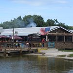 View from the dock, the grill is smoking, Old Glory flying, whilst guests enjoy the outdoors