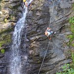 Wife and I rappelling down the waterfall