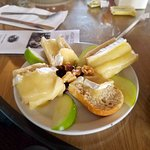 Brie on french bread with tart apples and walnuts