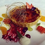 Desserts available Thurs-Sun 4pm til late. Creme Brulee Tart with berry coulis and fruit