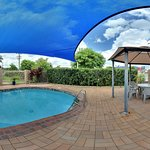 Shaded Pool with BBQ & Seating