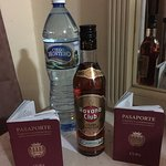 complimentary water and rum in the room