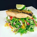 Pistachio crusted salmon with roasted capsicum and rocket salad