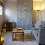 This is Room 3 - 1st floor double suite with comfy sofa and funky yellow arm chair