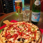Spicy salami pizza with olive and artichokes, Moretti Italian beer, San Pellegrino sparkling wat