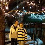 "Love under the ""fairy lights"" in front of Giuseppe's Pizza."