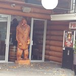 Carved bear at entrance from the patio