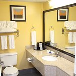 Tile floors and granite countertops - amenities include shampoo, conditioner & hair dryers