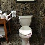 Room 180 - Closeup of commode area. No grab bar behind toilet.