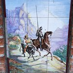 Don Quixote as told in murals outside Don Carlos