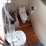 down stairs to hot shower and flush toilet