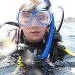 After 4 Open Water Dives - Qualified Jr. Open Water Diver.