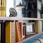 Library Books on Shelf with Decor Accent