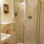 Room 3's detached bathroom comes equipped with a modern shower. The bath is private to only Room