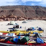 kayaks and tents on the beach