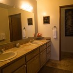 Residence Suite, Master Bathroom with two sinks and water closet.
