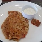 Tomato cheese paratha at breakfast