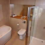 Generous new bath/shower room with good ventilation and floor heating.