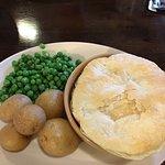 Homemade steak & veggies pie with boiled potatoes and peas