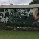 Mural showing aspects of Bob Marley's life.