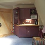 Wet bar area and sitting room in Suites