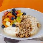 Bircher muesli with dukkah, fresh fruits and yoghurt