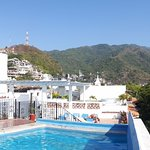 Rooftop pool with a view of the Mirador de la Cruz (the cross) and viewing tower.