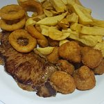 10oz sirloin steak with onion rings, buttered mushrooms.