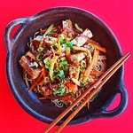Wok of chinese noodle, vegetables, handmade Tofu with our house Tokyo's style
