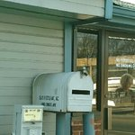 The local newspaper machine, mailbox and entry door to Bea's.