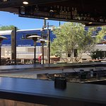 The outdoor bar is next to the boarding platform