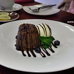 Warm Chocolate Cake served with Mövenpick vanilla ice cream