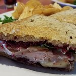 Turkey Brie Sandwich, packed with turkey, cranberry, and spinach. Great flavor, texture, and hug