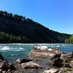 Standing at the side of the Niagara River at the base of the Niagara Gorge trail
