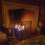 The bar has a warm and welcoming fire blazing in the hearth