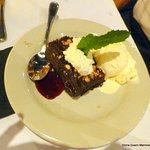 Macademia Nut Brownie with Raspberry Sauce & Vanilla Ice Cream