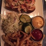 Lobster roll entree: lots of tasty cold lobster, pickels, coleslaw and home made fries. Yumm!