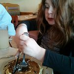 Daughter digs into her chocolate chip pancakes! They were delish!