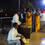 Traditional drum beaters and singers play at the function area