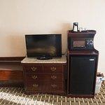 Refrigerator, microwave, TV, new granite top. New carpet.