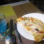 Pizza and Blue lagoon drink