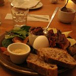 The brunch platter - bacon, priscuitto, bread, an egg, hummus, salad, fruit, skyr. Yum!