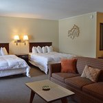Family Suite Has 3 Queen Beds and Sleeper Sofa, Spruce Building, Second Floor