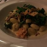 Gnocchi with wild mushrooms, broccoli and Parmesan crisps.